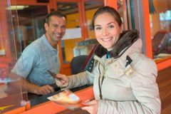 Portrait woman at ticket booth Stock Photography