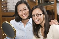 Portrait Of Women Trying Out Glasses Royalty Free Stock Image