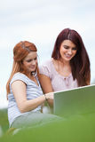 Portrait of women using a notebook Stock Images