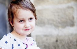 Portrait of a wonderful child girl us symbol of happy childhood, stock photo