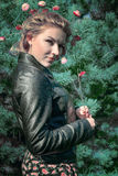 Portrait of wonderful girl in fir-tree wood with flowers Royalty Free Stock Image