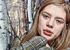 Close Up Portrait of a Teenage Girl in the Woods stock image