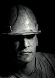 Portrait of the worker. On a black background Royalty Free Stock Images