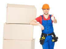 Worker delivery man with  boxes showing thumbs up Royalty Free Stock Photos