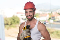 Portrait Of A Worker With Drill. Successful Male Architect At A Building Site With Drill Royalty Free Stock Image