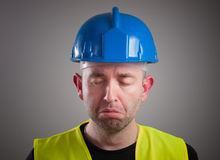 Portrait of a worker expressing negativity and sad Stock Images