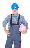 Portrait Of A Worker Holding Piggybank. Over White Background Royalty Free Stock Photo