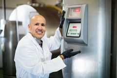 Portrait of worker near cisterns with milk Royalty Free Stock Photo
