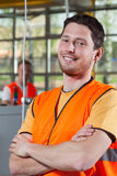 Portrait of a worker in orange protective vest Stock Photo