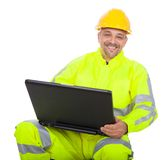 Portrait of worker in safety jacket. Working on laptop. Isolated on white Royalty Free Stock Photo