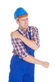 Portrait Of A Worker With Shoulder Pain Stock Photo