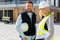 Portrait of a worker team at the end of the construction Stock Photos