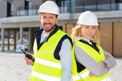 Portrait of a worker team at the end of the construction. View of a Portrait of a worker team at the end of the construction Royalty Free Stock Photo