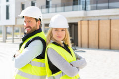 Portrait of a worker team at the end of the construction. View of a Portrait of a worker team at the end of the construction Stock Photos