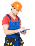 Worker with tools, planning and writing the note Royalty Free Stock Image