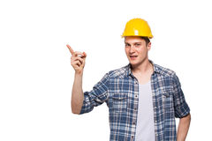 Portrait of a worker with yellow helmet on head. On white background Royalty Free Stock Photo