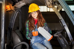 Portrait of a worker young girl on coffee break Royalty Free Stock Photo