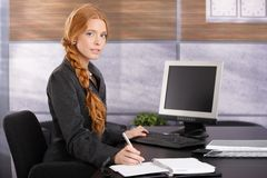 Portrait of working businesswoman Royalty Free Stock Image