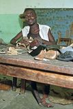 Portrait of working disabled Ghanaian Shoemaker Royalty Free Stock Photo