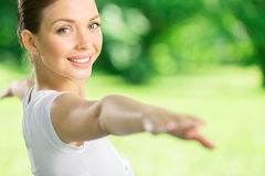 Portrait of working out girl with outstretched arms. Portrait of girl with outstretched arms exercising. Concept of healthy lifestyle and relaxation Royalty Free Stock Photo