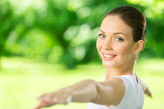 Portrait of working out woman with outstretched arms Stock Photos