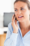 Portrait of a working woman speaking on the phone Royalty Free Stock Photos
