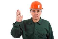 Workman in overalls and helmet showing different g Stock Photos