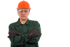 Workman in overalls and helmet showing different g Royalty Free Stock Image