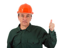 Workman in overalls and helmet showing different g Royalty Free Stock Photos