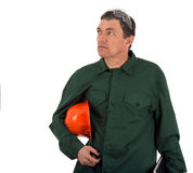 Workman in overalls and helmet showing different g Stock Photography