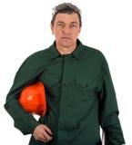 Workman in overalls and helmet showing different g. Portrait of a workman in overalls and helmet showing different gestures Stock Images