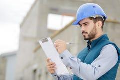 Free Portrait Workman Preparing Estimate For Work On House Royalty Free Stock Photo - 158695995