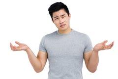 Portrait of worried man gesturing Stock Image