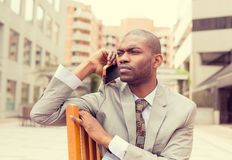 Portrait worried man talking on mobile phone outdoors Royalty Free Stock Photo