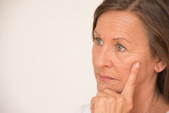 Portrait Worried mature woman thinking Royalty Free Stock Photography