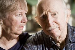 Portrait of Worried Senior Couple Stock Images