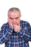 Portrait of a worried senior man Stock Photos