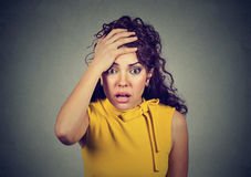 Portrait of a worried shocked woman stock photography