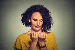 Portrait worried woman looking at hands fingers nails obsessing about cleanliness Royalty Free Stock Photography