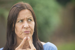 Portrait worried woman outdoor background Royalty Free Stock Photography