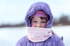 Portrait of wrapped in warm clothes small child Royalty Free Stock Photo