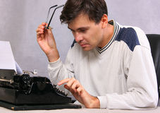 Portrait of writer. Author type bestseller by vintage typewriter Stock Images