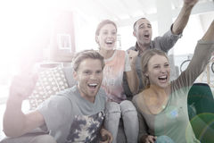 Portrait of y group of people being happy about the score Royalty Free Stock Images