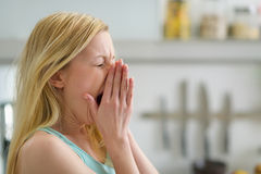Portrait of yawing woman in the morning in kitchen Stock Image