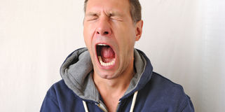 Portrait of the yawn man Royalty Free Stock Photography