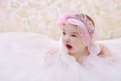 Cute yawning baby portrait. Portrait of yawning baby girl Stock Photos