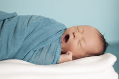 Portrait of yawning newborn baby girl yawning Royalty Free Stock Images