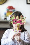 Portrait of a child with carnival mask Stock Image