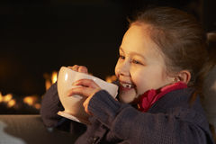 Portrait 7 year old girl by firelight Stock Photography