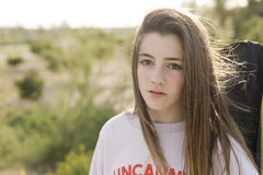 Portrait of a 15 year old teenage girl. Photographed in backlight Stock Photography